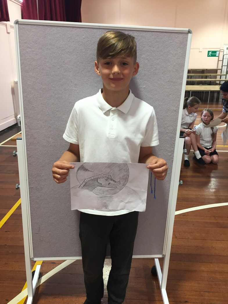 Andrew with his amazing drawing of a dragon